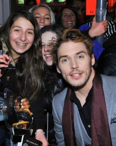 I had to post this photo that I found on a Gossip Site... it is of me photobombing two teenaged girls photo with Sam Claflin. Hilarious.